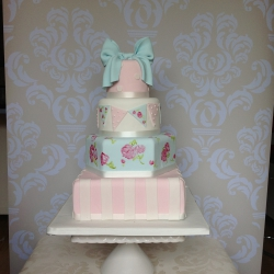 Four tier cake, stripes, bow, pink, blue, wedding cake, pastel colours