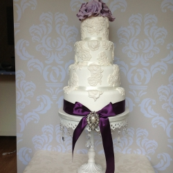 Four tier cake, purple bow, wedding cake