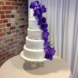 Five tier cake, purple flowers, wedding cake, tiers, cake detail