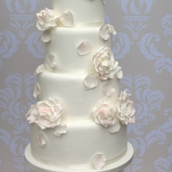 5 tier with full blown roses and falling petals