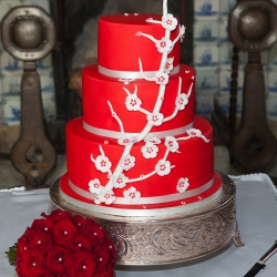 Three tier cake, bold red, white blossom, red, white, blossom, wedding cake