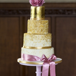 Four tier cake, bow, gold dust, wedding cake