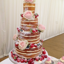 Four tier cake, wedding cake, petals, cupcakes