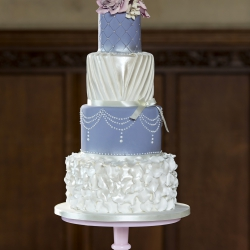 Four tier cake, pleats, ruffles, wedding cake
