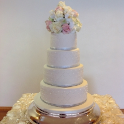 Four tier cake, quilts, flowers, wedding cake