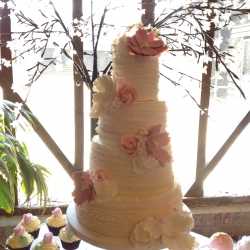 Four tier cake, ruffles, pink, white, wedding cake