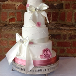 Four tier cake, bows, pink ribbon, wedding cake