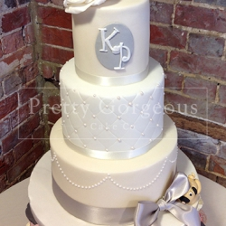 Three tier cake, silver ribbon, pearls, cupcakes, wedding cake