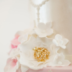 Gold detail, flowers, pearls, wedding cake