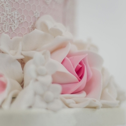 Pink detail, petals, ribbon, wedding cake