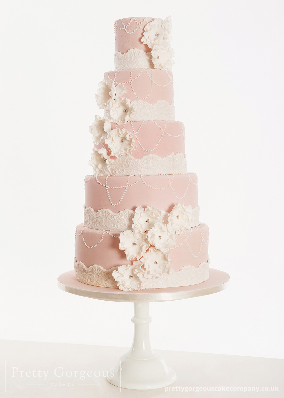 Five tier cake, pearls, frills, wedding cake