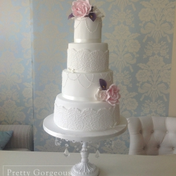 Four tier cake, roses, pearls, wedding cake