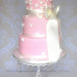 Soft pink, white roses, hydrangeas, ribbons, three tier, wedding cake