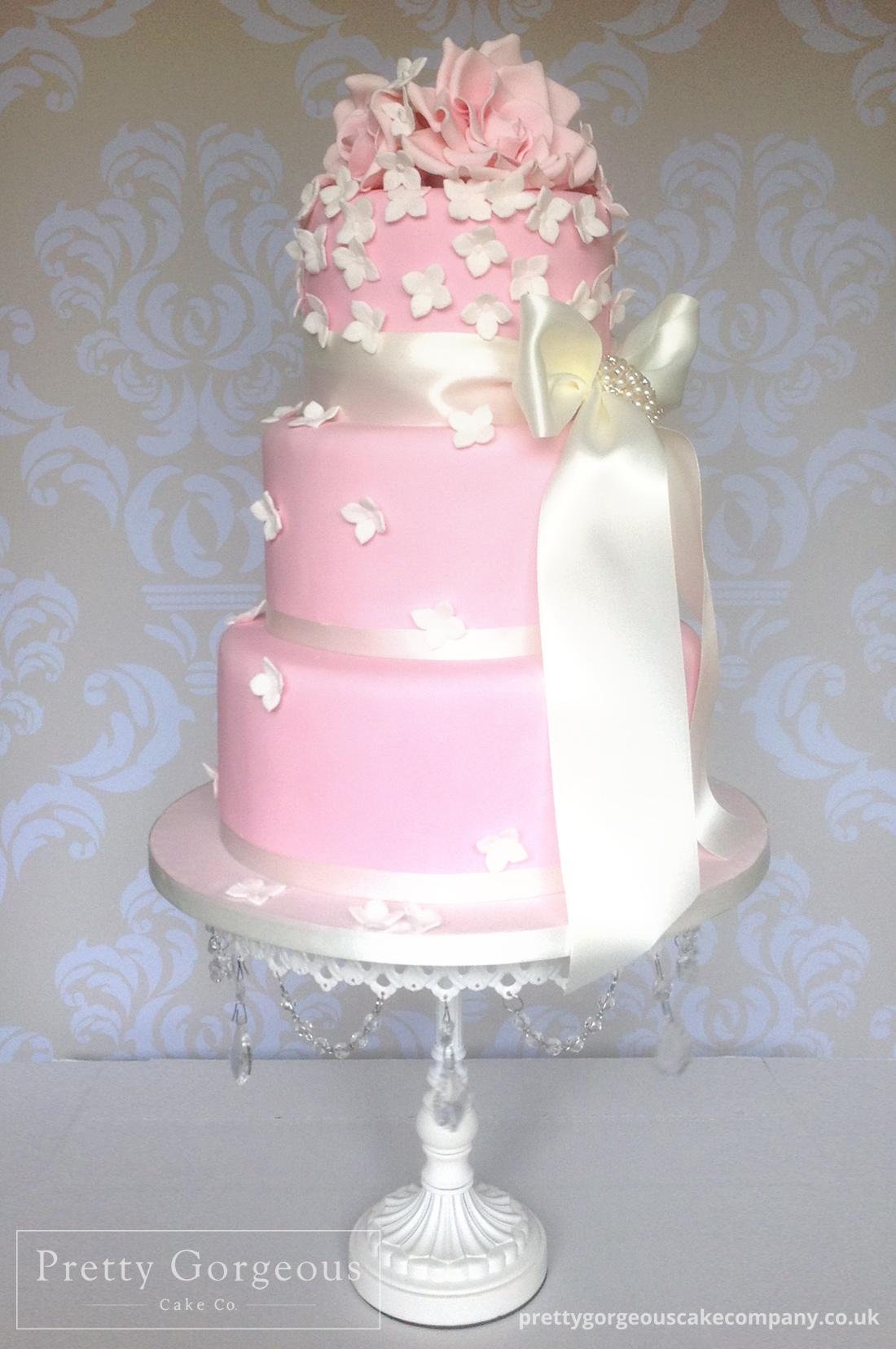 Soft pink, white roses, hydrangeas, ribbons, three tier, wedding cake